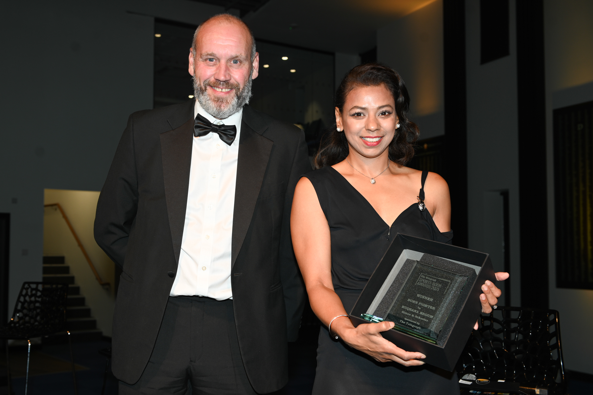 Ruqsana Begum collects her trophy for 2021 Telegraph Autobiography of the Year, Born Fighter